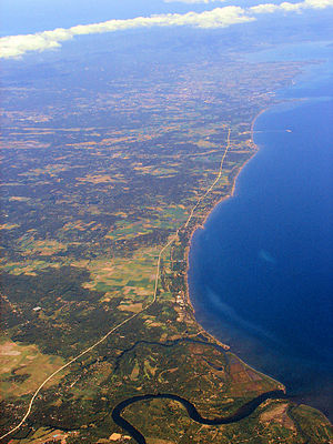 Sariaya - Aerial view of Sariaya's coast with Lucena City in the background.