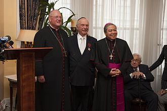 Arthur Schneier - Schneier being conferred with a Papal Knighthood. From left, Cardinal Timothy M. Dolan, Rabbi Arthur Schneier and Archbishop Bernardito C. Auza