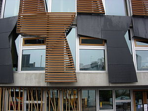 "Scottish Parliament Building - ""Trigger panels"" either an abstract of the skating minister or curtains drawn back from the windows."