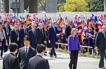 Secretary Kerry and His G7 Counterparts Pass School Children Upon Arrival at the Hiroshima Peace Memorial Park (26270766322).jpg