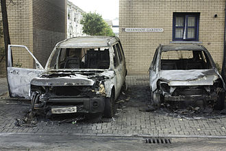 Cars damaged by arson in Hackney, Greater London, during the 2011 England Riots Sherwood Gardens Riots 03.jpg