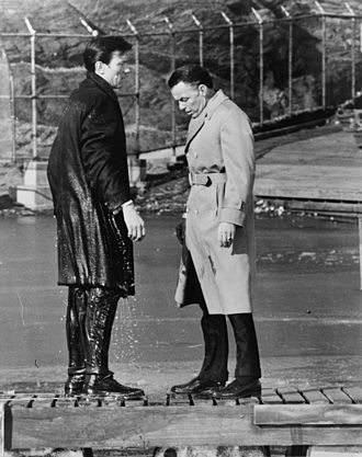 The Manchurian Candidate (1962 film) - Shaw (Harvey, left) with Major Marco (Sinatra) after having jumped into a lake in New York City's Central Park when his programming was accidentally triggered