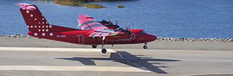 Sisimiut Airport - The four-engine DHC-7 of Air Greenland landing at Sisimiut Airport after the shuttle flight from Kangerlussuaq Airport.