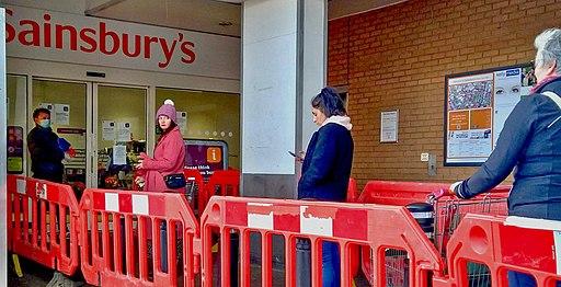 Social distancing queueing for the supermarket J. Sainsbury's north London Coronavirus Covid 19 pandemic - 30 March 2020