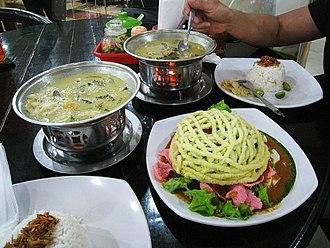 Betawi cuisine - Betawi dishes; soto betawi and asinan betawi in a Betawi restaurant at Sarinah, Central Jakarta.