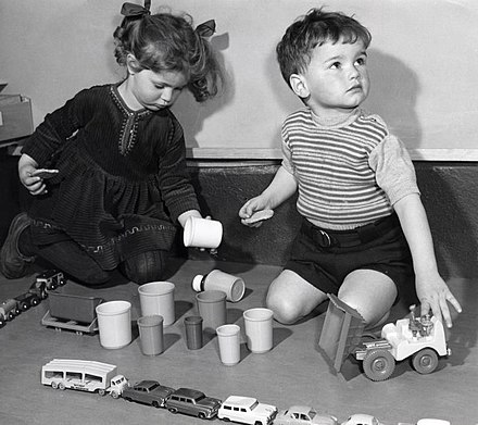 Two Dutch children playing with toys (1958). The 1950s and 1960s were an economically prosperous time in the West.
