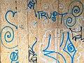 Sprayed graffiti on a wooden wall, like ornaments - Amsterdam city.jpg