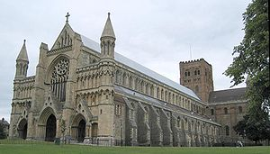St Albans Abbey following restoration. A mix of architectural styles and a pitched roof.