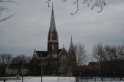 the front of St. Michael's Church from across a snowy baseball field