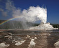 Steam phase eruption of Castle Geyser with rainbow.jpg