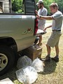 Steve Fraley and Nick Bowman unloading bags of spotfin chubs (4773888853).jpg