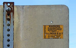 Street sign theft - A sticker on the back of this Illinois street sign is intended to deter theft.