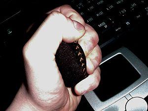 English: Manipulation of a stress ball, laptop...