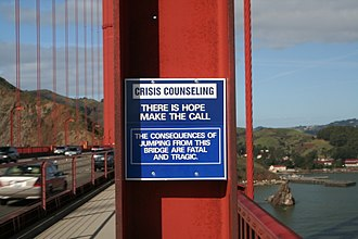 Crisis hotline - As a suicide prevention initiative, this sign on the Golden Gate Bridge promotes a special telephone that connects to a crisis hotline.