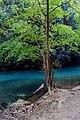 Sungai berwarna biru yang mengalir ke air terjun Bantimurung.jpg