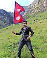 Sunil Giri raising Flag of Nepal.jpg