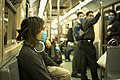 Swine Flu Masked Train Passengers in Mexico City.jpg