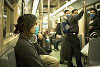 People in Mexico City wear masks on a train due to the 2009 swine flu outbreak