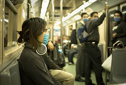 People in Mexico City wear masks on a train due to the swine flu outbreak, April 2009 Swine Flu Masked Train Passengers in Mexico City.jpg
