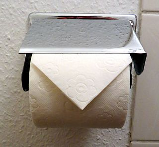 Hotel toilet paper folding Common practice performed by hotels worldwide as a way of assuring guests that the bathroom has been cleaned