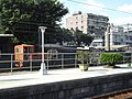 TRA DL-1102 and open railway wagons at Ruifang Station 20141016b.jpg