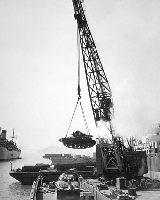 Battle of Pusan Perimeter - An M4 Sherman tank being loaded into a barge at the port of Oakland, California, prior to shipment to Pusan, 1950.