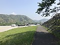 Tenshu of Iwakuni Castle and Kintaikyo Bridge from bed of Nishikigawa River.jpg