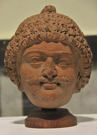 Terracotta - Terracotta head from Akhnoor, Kashmir. Head dates back to 6th century AD. On display in Prince of Wales Museum