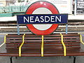 TfL roundel and bench at Neasden tube station, London 6 June 2011.jpg