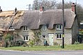 Thatched cottage being partly re-thatched - geograph.org.uk - 386128.jpg