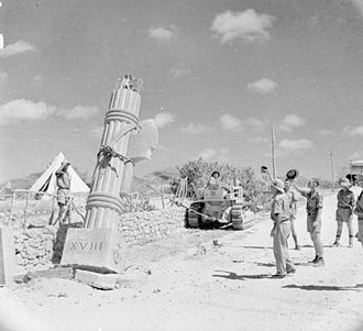 Brian Robertson, 1st Baron Robertson of Oakridge - British troops demolish an Italian monument at Kismayu on 11 April 1941