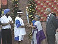 The Chief Minister of Delhi Smt. Sheila Dikshit handing over the Olympic Torch to the President.jpg