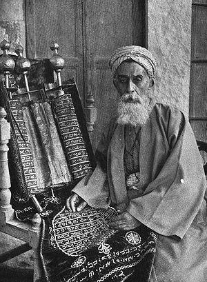 Tsvi Misinai - Samaritan High Priest with the Paleo-Hebrew alphabet Samaritan Torah, Nablus, c. 1920.