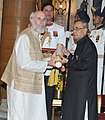 The President, Shri Pranab Mukherjee presenting the Padma Bhushan Award to Mr. David Frawley, at a Civil Investiture Ceremony, at Rashtrapati Bhavan, in New Delhi on March 30, 2015.jpg