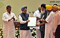 The Prime Minister Dr. Manmohan Singh presenting the Krishi Karman award to the Chief Minister of Punjab, Shri Parkash Singh Badal, at the 83rd ICAR Foundation Day function.jpg