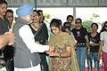 The blind girls from Vocational Training Institution tying 'Rakhi' to the Prime Minister, Dr. Manmohan Singh, on the occasion of 'Raksha Bandhan', in New Delhi on August 09, 2006.jpg