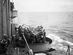 The port eight barrelled Vickers two pounder Mk VIII 'pom-pom' gun in action during anti-aircraft practice on board HMS RODNEY, October 1940. A1408.jpg