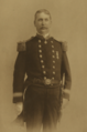 Thomas Skelton Harrison. In the uniform of a Lieutenant-Commander, United States Navy.png