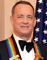 Tom Hanks posing for a photo after a dinner hosted by U.S. Secretary of State John Kerry at the U.S. Department of State in Washington, D.C., on December 6, 2014.