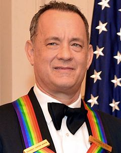A close up photograph of Tom Hanks smiling while receiving The Kennedy Center Honors Medallion
