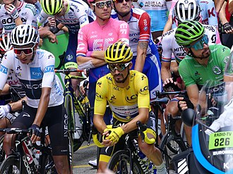 Leaders of the young rider, general and points classifications Egan Bernal, Julian Alaphilippe and Peter Sagan, respectively, lining up before stage 19. Sagan led from the end of stage 2 to win a record seventh green jersey. Tour de France 2019 - Maillot jaune sur la ligne de depart de la 19eme etape.JPG