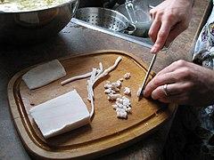 Unrendered lard, being diced to prepare tourtière.