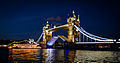 Tower Bridge opening at night for a ferry.jpg