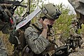 U.S. Air Force Senior Airman Edward Stewart, a Tactical Air Control Party specialist attached to 2nd Battalion, 5th Infantry Regiment, communicates with supporting aircraft during a training exercise at 130718-A-HU280-486.jpg