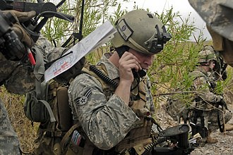 4th Air Support Operations Squadron - A USAF Tactical Air Control Party specialist communicates with supporting aircraft during a training exercise