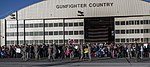 U.S. Airmen, family members and friends gather at Mountain Home Air Force Base, Idaho, Oct. 3, 2013, for a homecoming ceremony for Airmen with the 366th Maintenance Group and the 389th Fighter Squadron who are 131003-F-WU507-161.jpg
