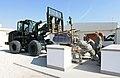 U.S. Airmen move a renovated grill into place at Al Udeid Air Base, Qatar, Jan. 9, 2014 140109-Z-QD538-031.jpg
