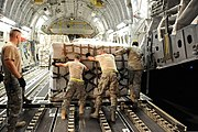 U.S. Airmen with the 386th Expeditionary Logistics Readiness Squadron load pallets of humanitarian relief supplies onto a C-17 Globemaster III aircraft at an undisclosed location in Southwest Asia June 4, 2013 130604-F-KL201-115