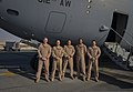 U.S. Airmen with the 816th Expeditionary Airlift Squadron (EAS) pose for a group photo in front of a C-17 Globemaster III aircraft at Al Udeid Air Base, Qatar, Jan. 9, 2014 140109-F-AM664-007.jpg