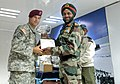 U.S. Army Capt. Matthew Hickey accepts the Indian Army High Altitude Warfare School's Best Student Trophy from the school's commandant, Maj. Gen. K.C. Singh.jpg